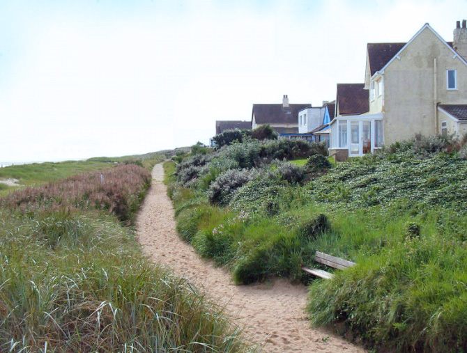 The pathway between the beach houses and the beach.
