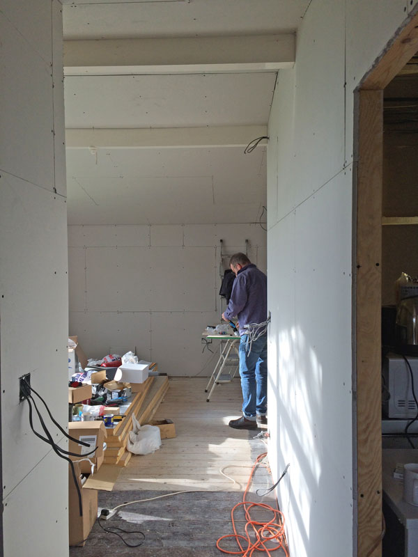 The view from the door, all plasterboarded and first fixed. Behind Jon will be a library/study area.